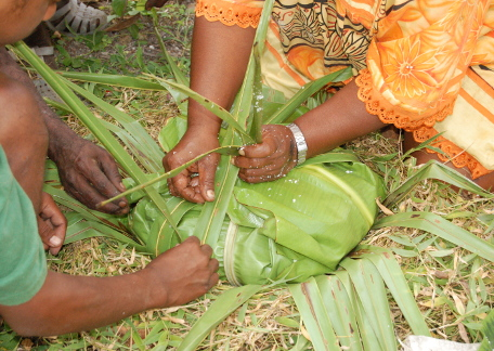 Preparing a Kanak bougna in a bed of banana leaves
